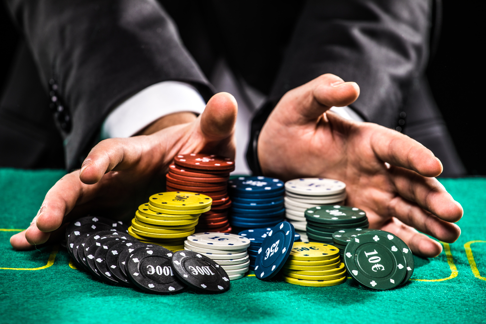 A man gambling on a poker table.