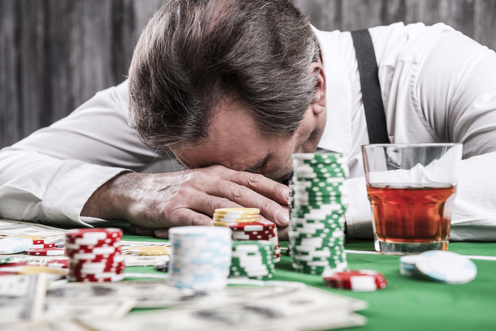 A man struggling with gambling addiction.